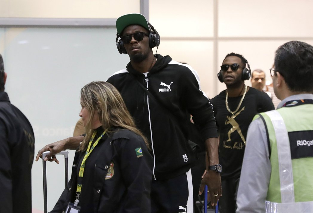 「牙買加閃電」柏特(戴耳機者)已抵達里約。 美聯社