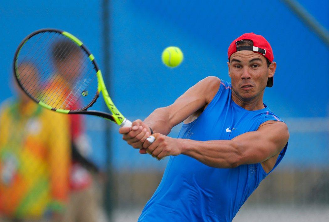 全力爭取獎牌,納達爾不退出網球任何項目。 美聯社
