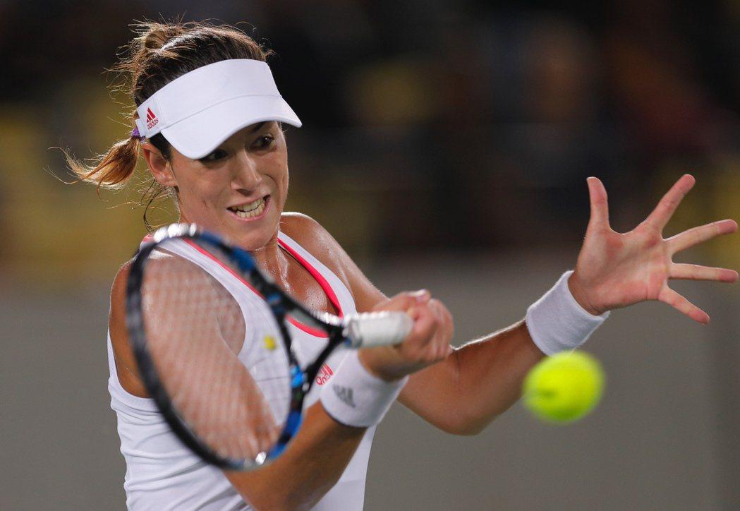 在法國公開賽奪冠的西班牙網球女將蒙奎露薩今天在奧運網球女單爆冷出局。 美聯社