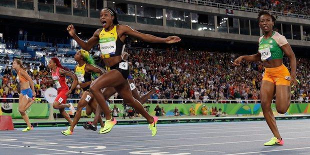 女子百米賽場上,女跑將幾乎都穿NIKE跑鞋,成為有趣現象。圖/美聯社