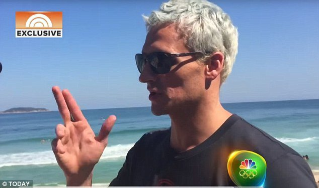 羅克特在里約對NBC描述他被搶的經過,掀堤了濤天大浪。(NBC網)