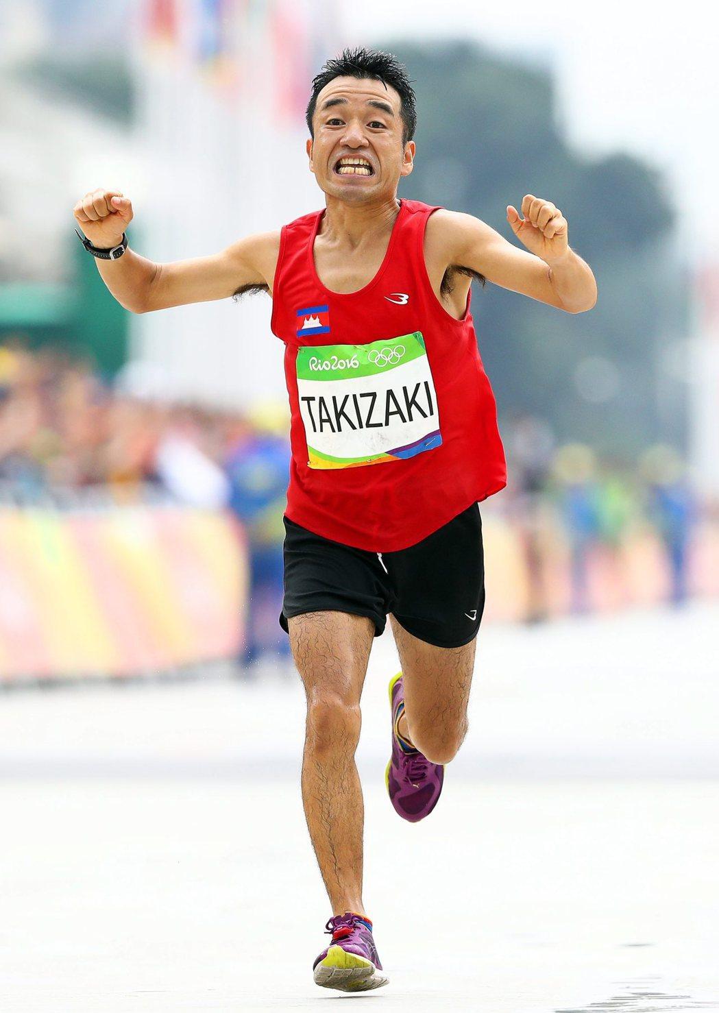 日本藝人貓廣志參加馬拉松比賽,以倒數第二完賽。 歐新社