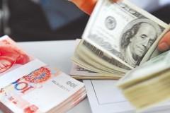 聯準會釋放降息訊號 人民幣兌美元中間價大漲逼近6.88