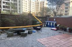 台中年輕男躺大樓花圃頭破腸流亡 非承租戶警急查身分