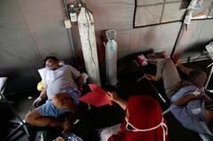 印尼單日增逾2.1萬確診創紀錄 病患大量湧入醫院