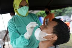 印尼單日確診逾5萬 取代印度成亞洲疫情最慘國家