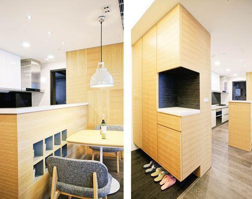在玄關規劃鞋櫃與廚房吧檯,遮住廚房的瓦斯爐台,解決原本開門見灶的狀況。攝影_Am...