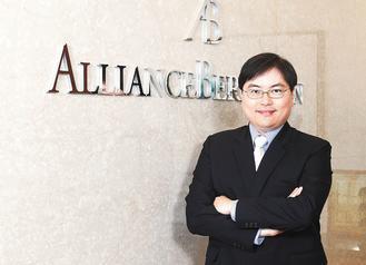 聯博新興市場企業債券基金經理人陳俊憲