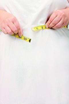 藥妝店門口,「靠飲食減2公斤,康孅伴再替你多減1公斤」的人形立牌,十分顯眼,吸引...