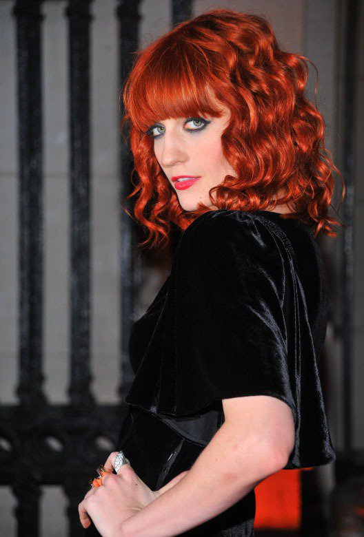 Florence Welch的鮮橘紅色髮型正是她的正字標記。圖/達志影像提供