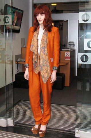 Florence Welch的裝扮也是十分搶眼,中性套裝是她最常曝光的造型。圖/...