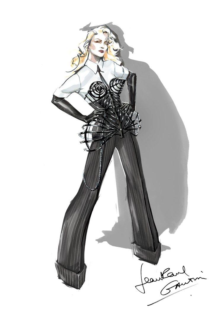 高堤耶此次的設計理念是將套裝與緊身馬甲結合,馬甲像是一個立體的籠子,以3D的方式...