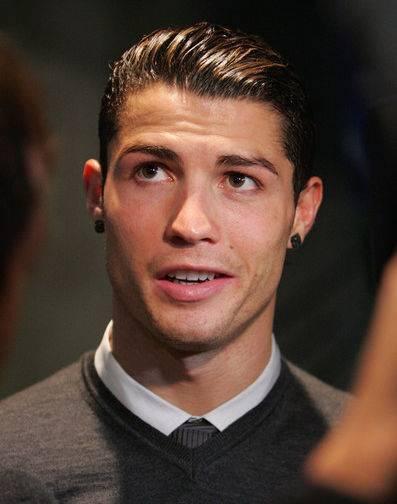 葡萄牙足球金童C羅是髮膠迷、髮膠重度成癮者,也時常梳西裝頭。圖/達志影像