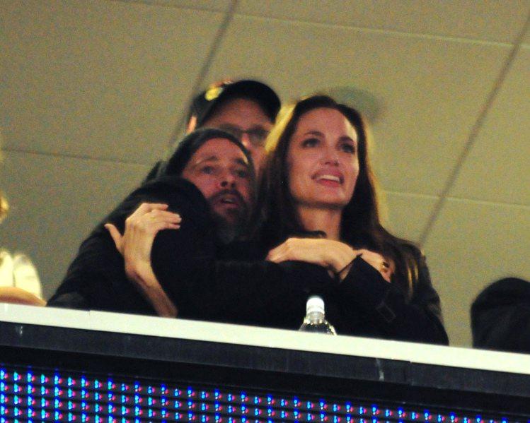布裘曾在看球賽時,上演恩愛秀。圖/達志影像