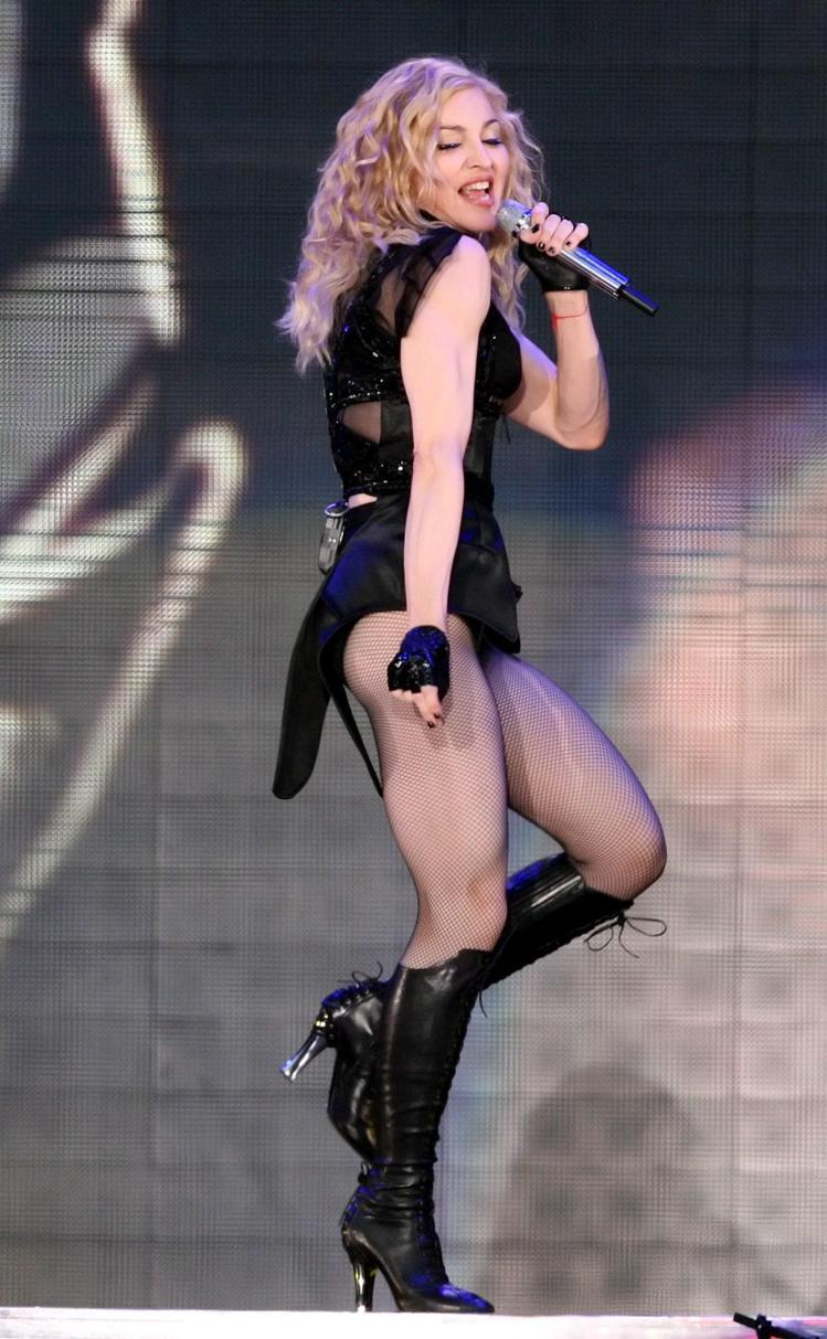 瑪丹娜最著名的「二頭肌」更是讓她引以為傲的驚人健美標誌。圖/歐新社