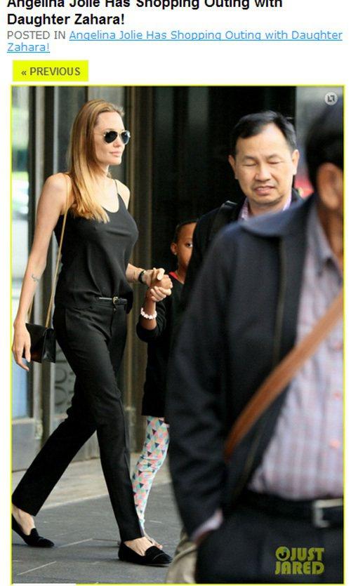 背著 Saint Laurent 的黑色小方包,穿了件基本款黑背心搭窄管西裝褲的...