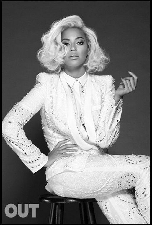 碧昂絲穿起佈滿鑲飾的白西裝,演繹高貴奢華的仕女風采。圖/擷取自out.com