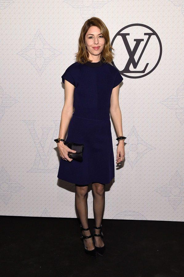 蘇菲亞柯波拉(Sofia Coppola)穿深藍色小洋裝與會,低調而優雅。圖/法...