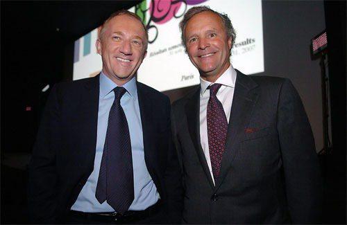 PPR老董(左)與旗下GUCCI的CEO(右) 合照。圖/彭博提供