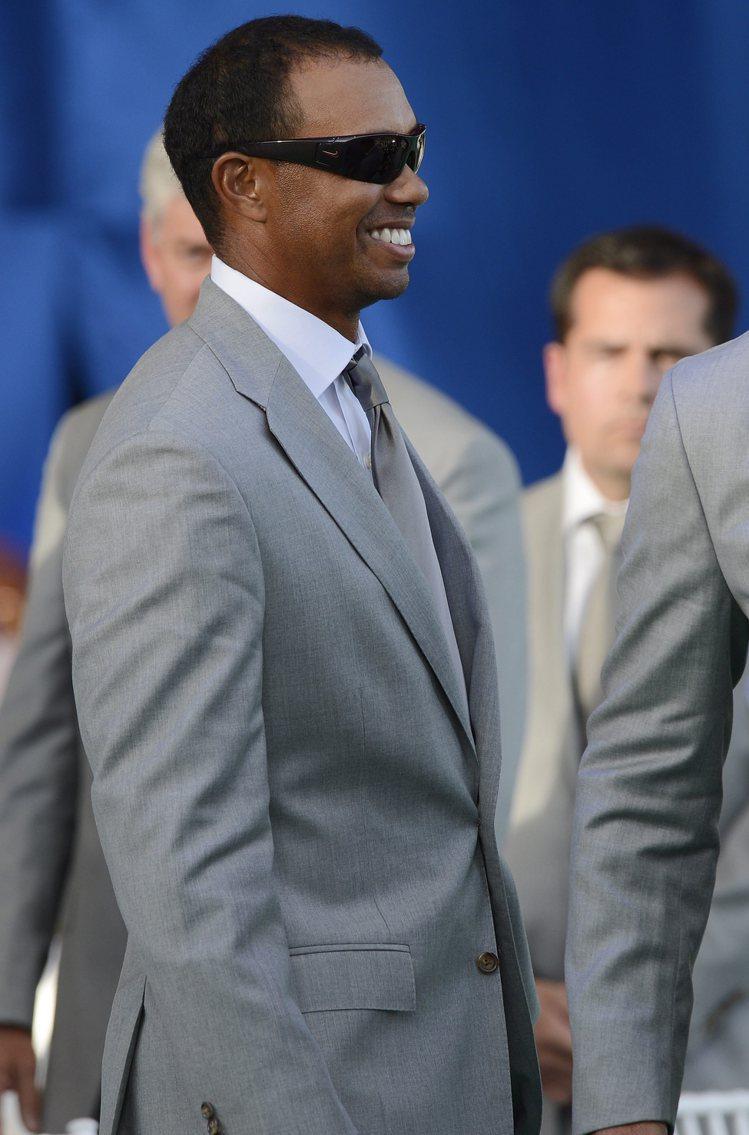 老虎伍茲也算是黑人運動員裡穿得講究的例子。圖/美聯社