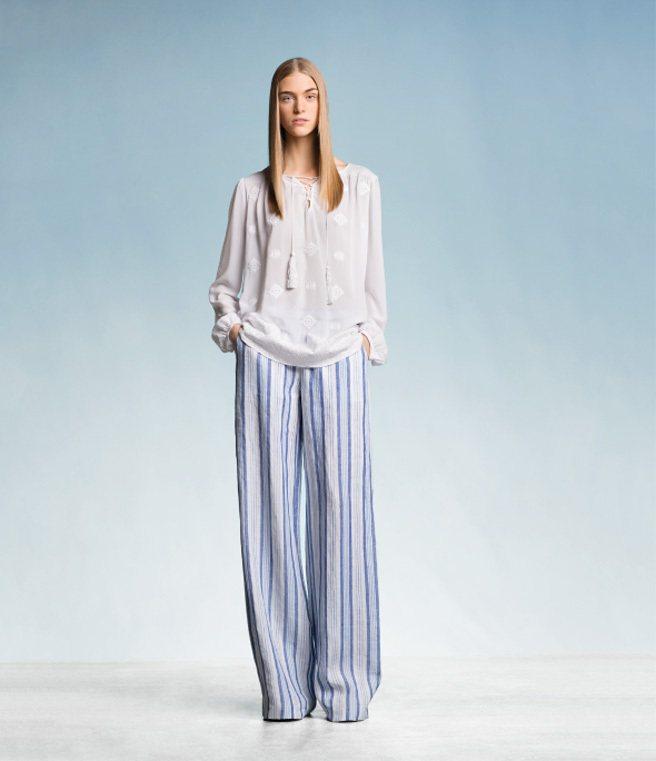 潔淨的白、寬鬆的長褲,帶出MICHAEL KORS夏季吉普賽融合海洋風的主軸。圖...
