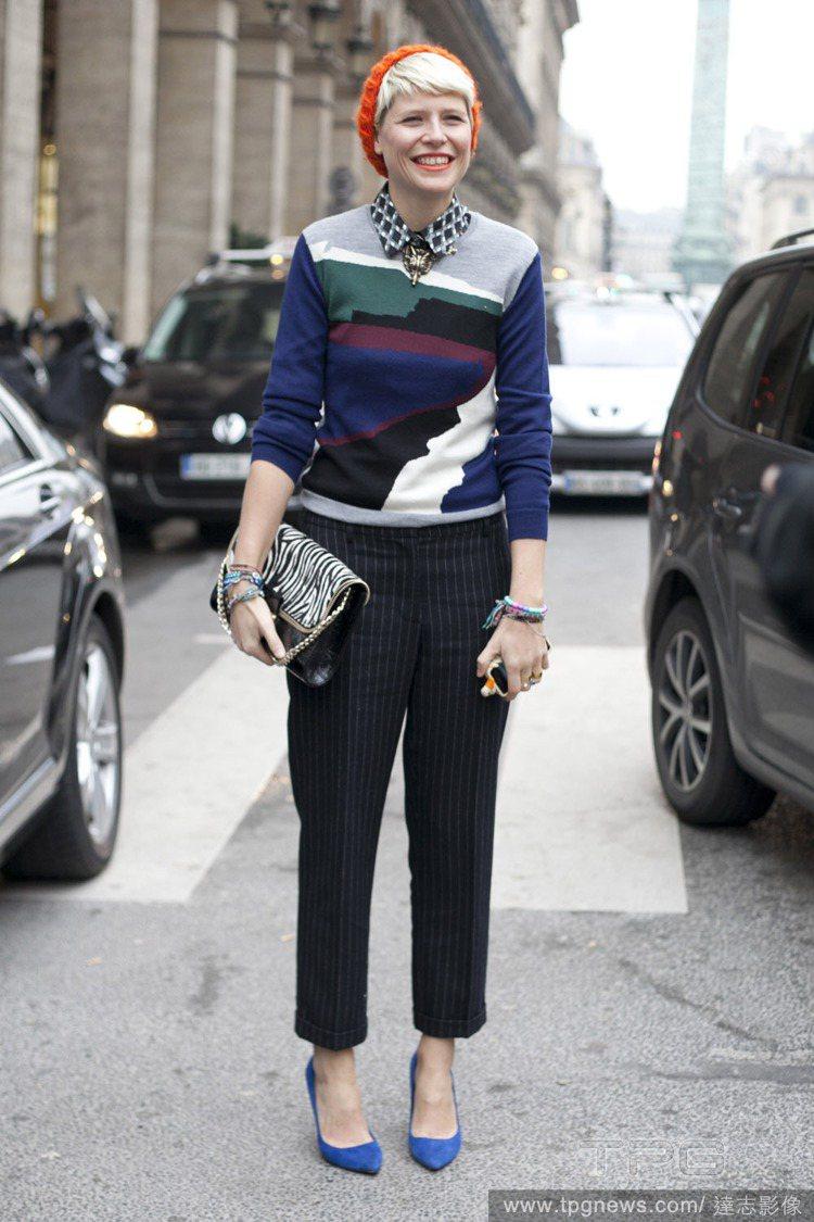 利用對比色讓毛帽巧妙搭配服裝。圖/達志影像