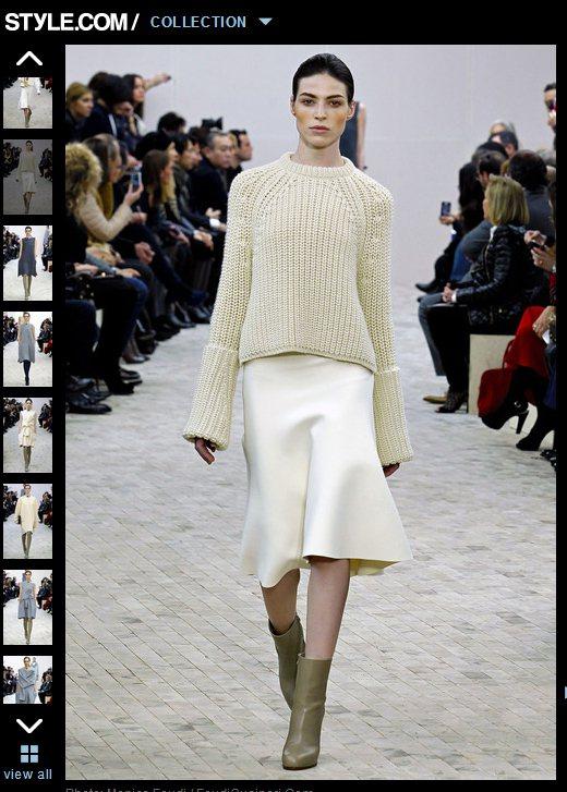 散發端莊氣質的「緞面裙」也能讓毛衣更時尚有型。圖/擷取自style.com