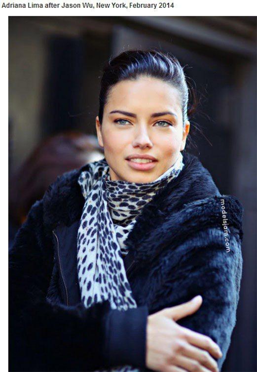 Adriana Lima 在紐約時裝周趕場,冷得要命的天氣讓她穿上刷毛黑色外套搭...