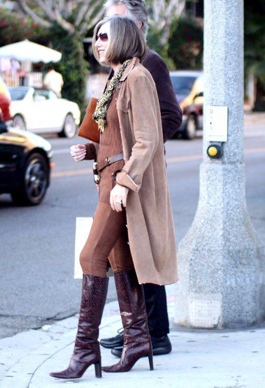 尖頭長靴「銳利、輕盈」的質感,展現「打扮的企圖心」。圖/達志影像