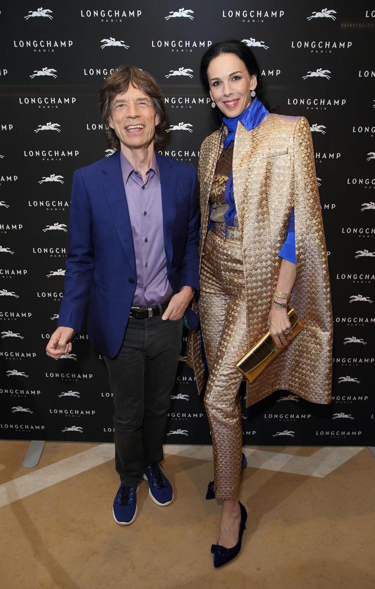 美國時尚設計師L'Wren Scott與滾石樂隊主唱Mick Jagger)出席...