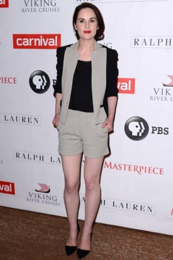 米雪道克利米黑撞色套裝展現女性瀟灑都會時尚。圖/she.com Taiwan提供