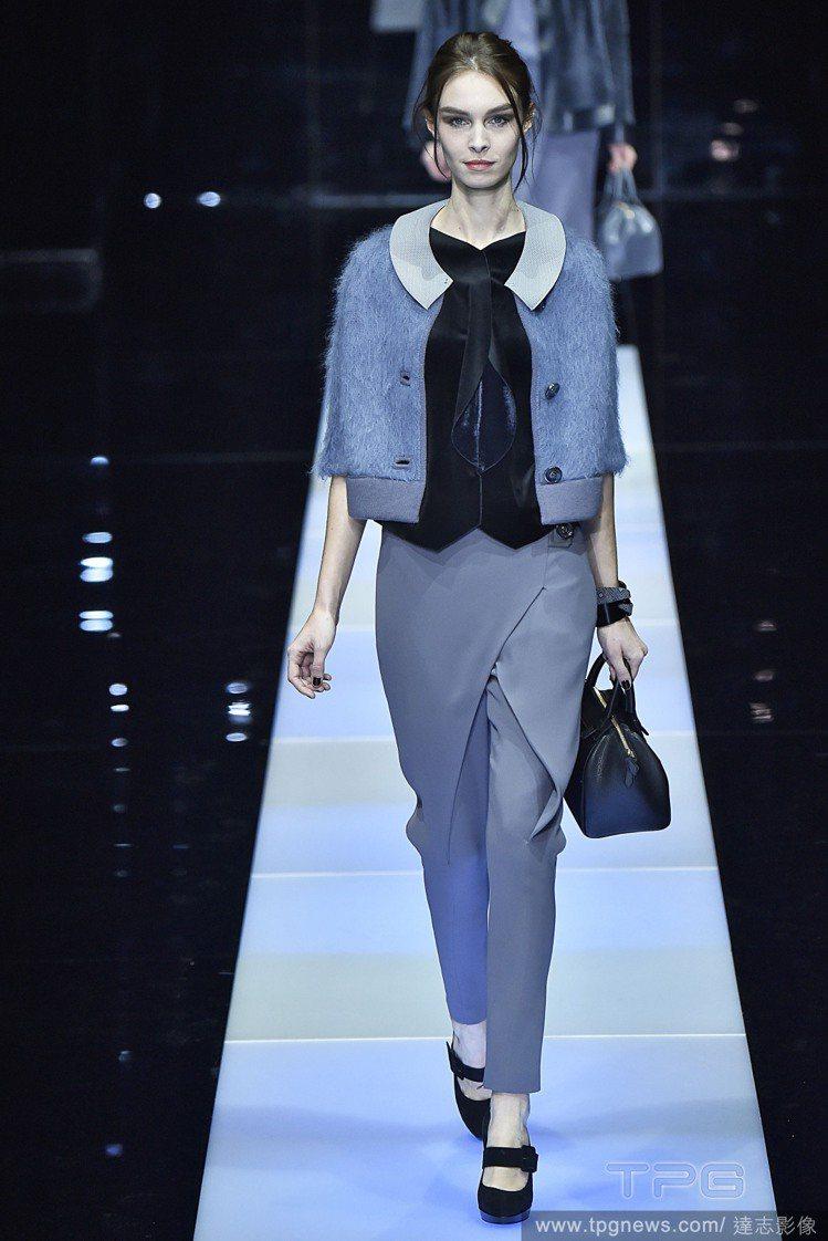 有不同材質、色塊拼接的藍色短外套可打造俏皮裝扮。圖/達志影像