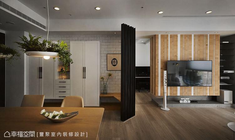 ▲文化石牆的磚框細線輪廓和木皮白牆、清水模,與鐵件的豐富交織,提升了空間暖度。