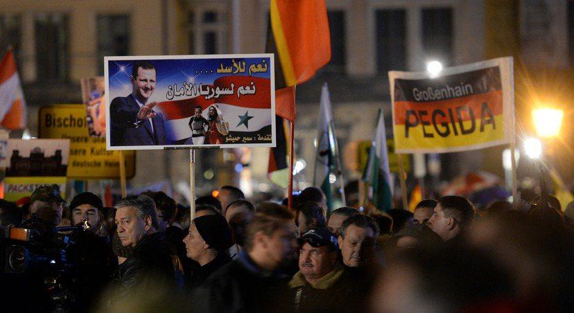 「愛國歐洲人反對西方伊斯蘭化」(Pegida)右翼團體在德萊斯登的抗議遊行。圖/...