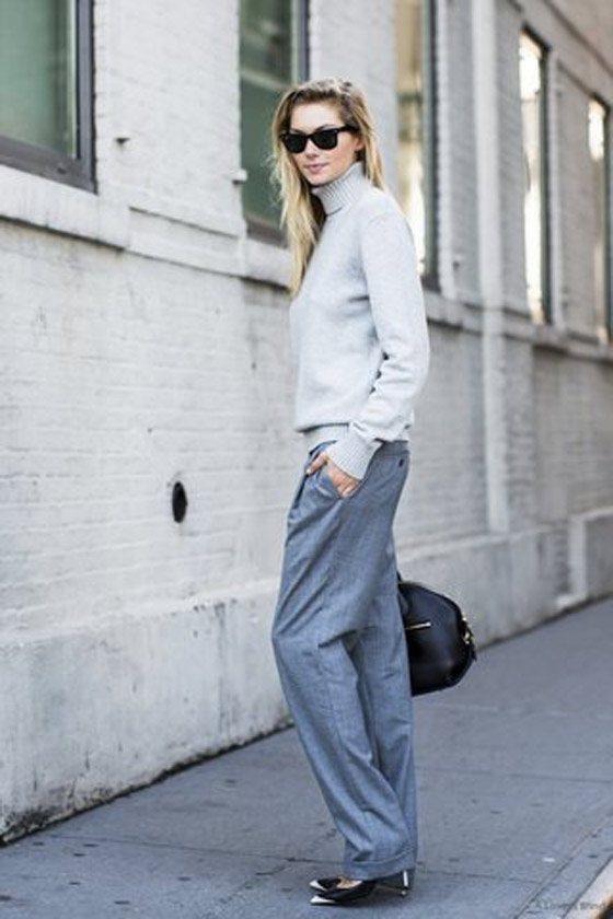 白色高領毛衣與灰色西褲搭出了職場幹練的女強人風。圖文:悅己網