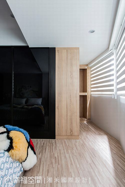 ▲L型衣櫃: 在大樑下方打開一整面窗景,藉此引入充沛光源,並以L型的木紋做為更衣...