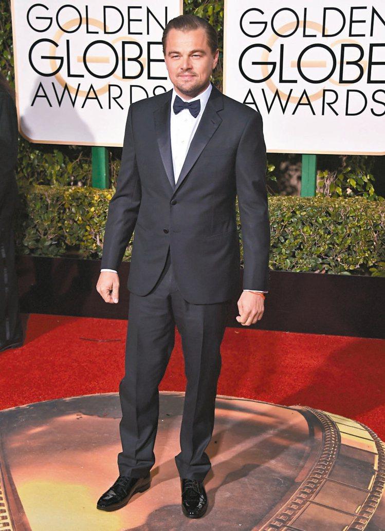 李奧納多在奧斯卡頒獎典禮上,選穿亞曼尼西裝拿下影帝。 圖/美聯社