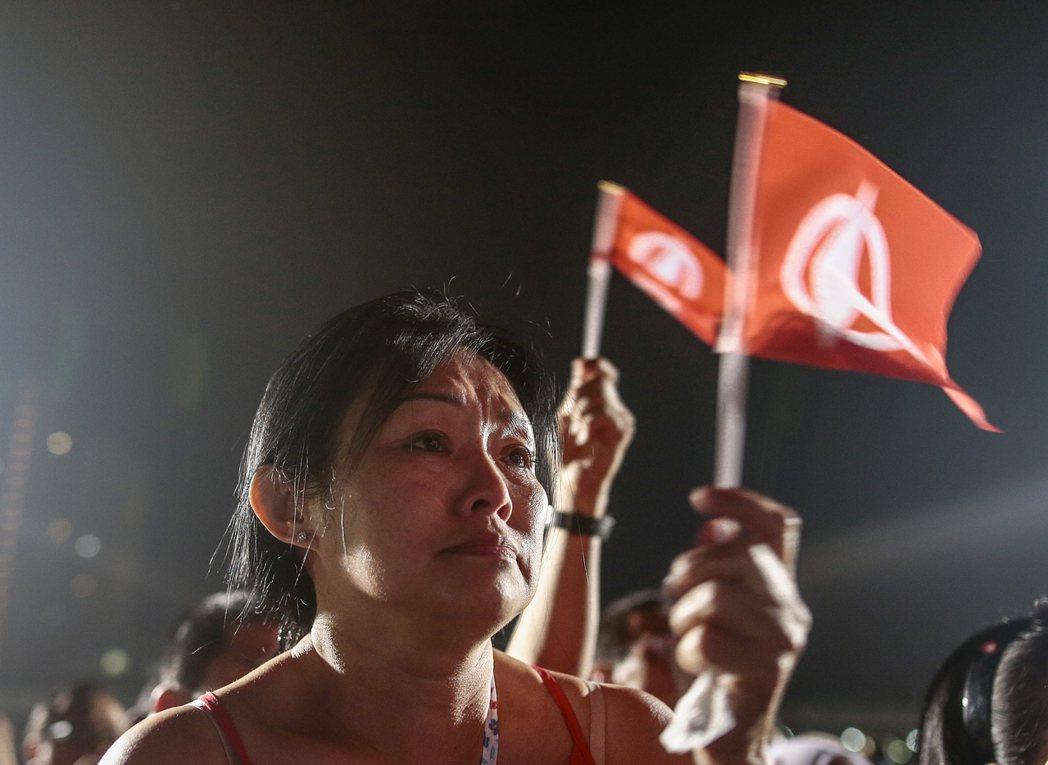 看似稀鬆平常的選戰,卻意外地投射出了新加坡民間對於自己的「微妙想像」。 圖/歐新...