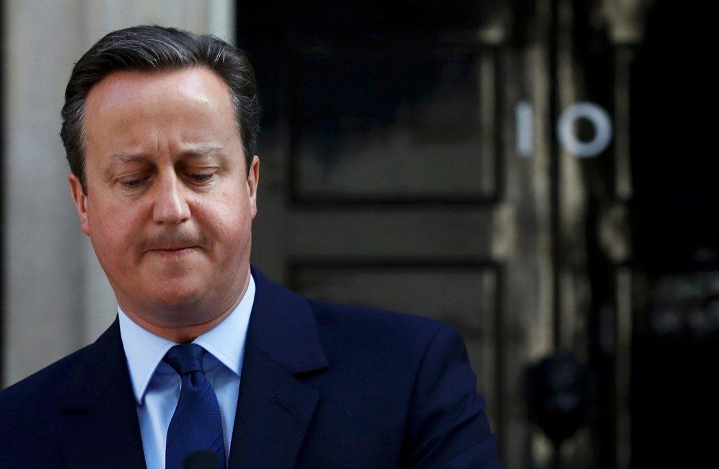 首相卡麥隆預告將在秋天新會期開始前離職。 圖/路透社