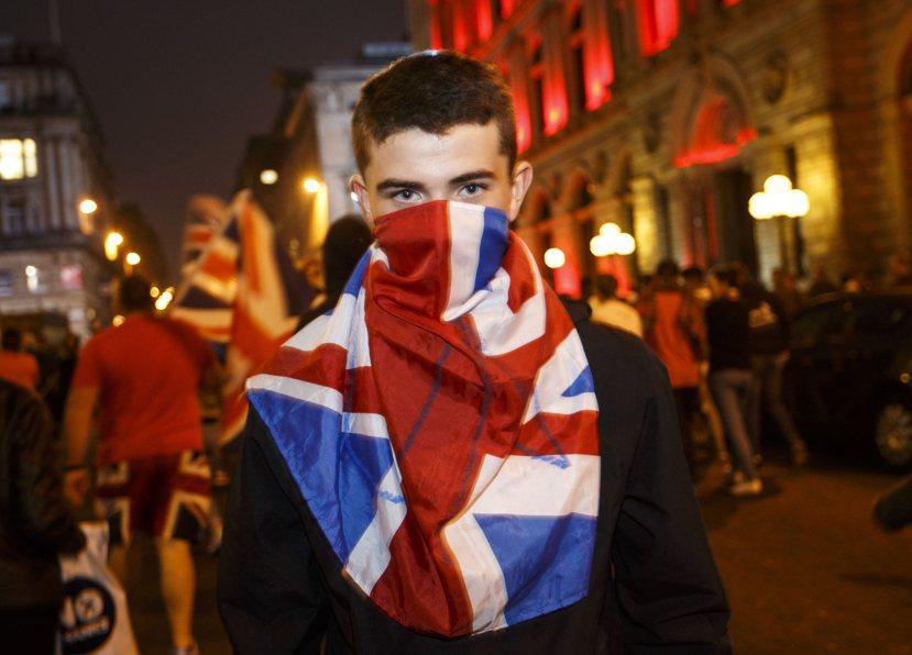 2014年9月19日,蘇格蘭獨立公投結果出爐,勝出的留英派在愛丁堡街頭慶祝。 圖...