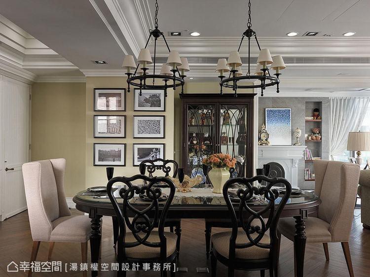 ▲對稱比例:湯鎮權設計師依照柱體尺度,安排等寬餐具櫃形塑對稱比例,並透過掛畫修飾...