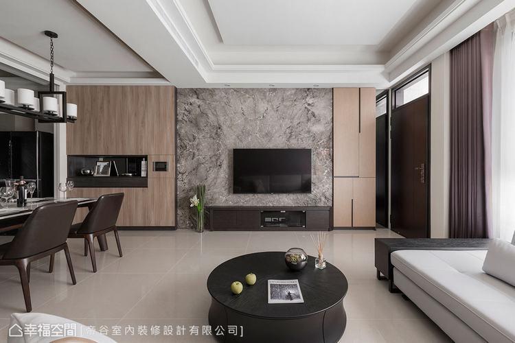 ▲電視牆:以大理石打造而成,透過不對稱的分割線條造型,與玄關木皮鞋櫃做銜接,搭配...
