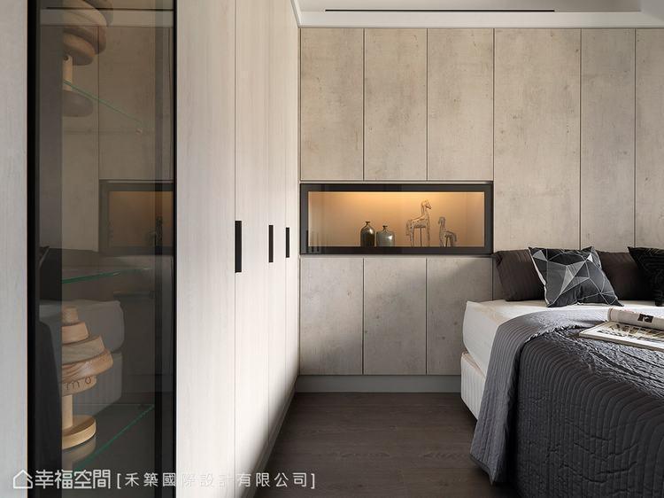 ▲男孩房:利用櫃體的設計,讓原先斜向的牆線切齊,修飾出方正的空間感。