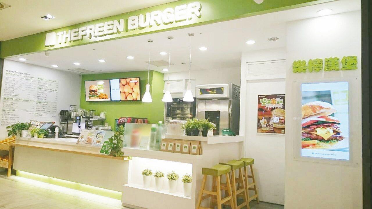 樂檸漢堡店面以綠色和白色為主調,明亮舒適。 圖/樂檸漢堡提供
