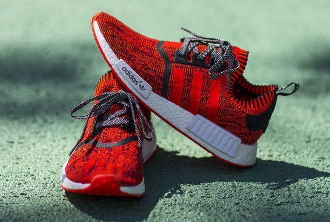 紐約限量「紅蘋果」NMD鞋,近日在eBay拍出近2,000美元高價。圖/adid...