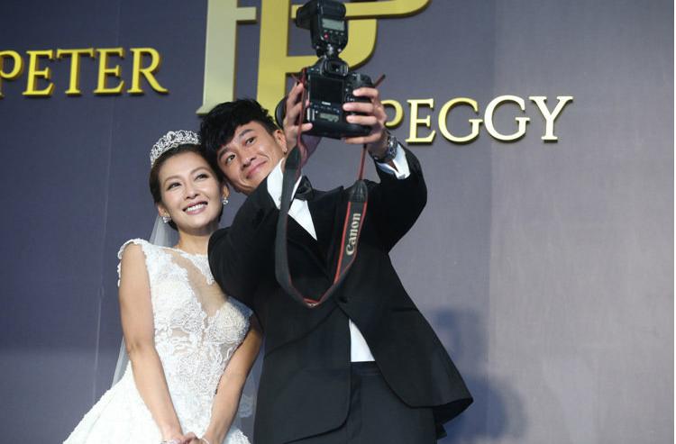 何潤東、林靜儀大婚,兩人搞怪拍照。本報資料照片