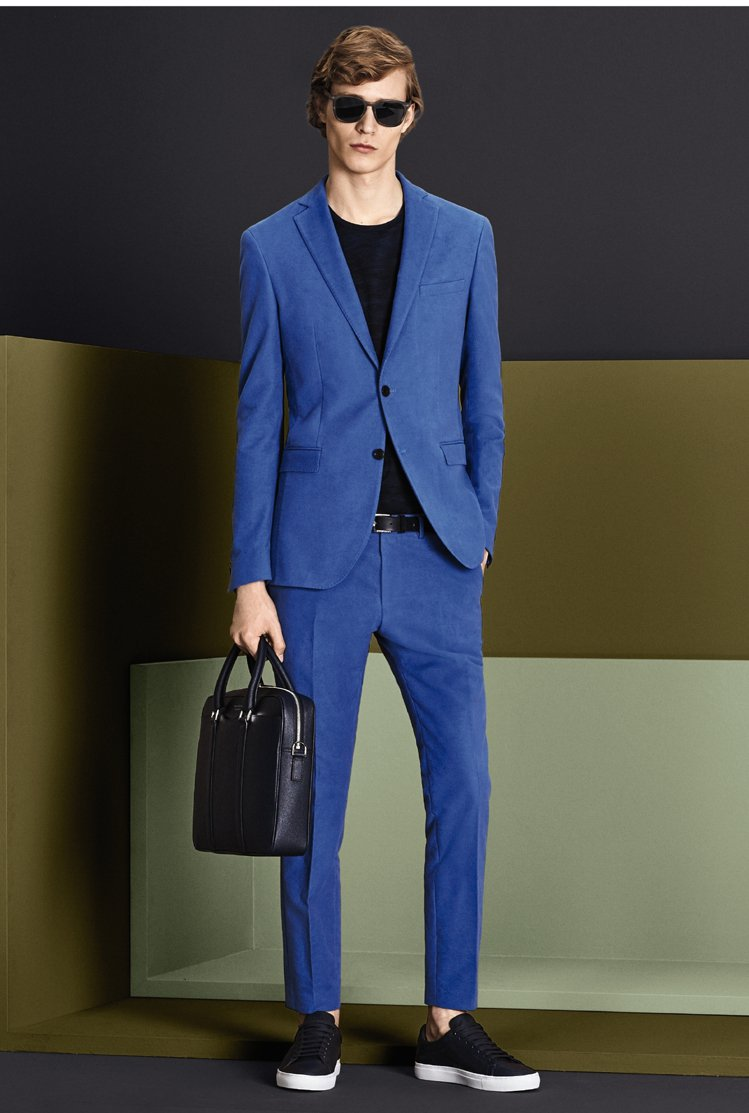 HUGO BOSS秋冬男裝以風雅的藝術格調呈現光與影的契合交錯,亮色西裝穿出年輕...