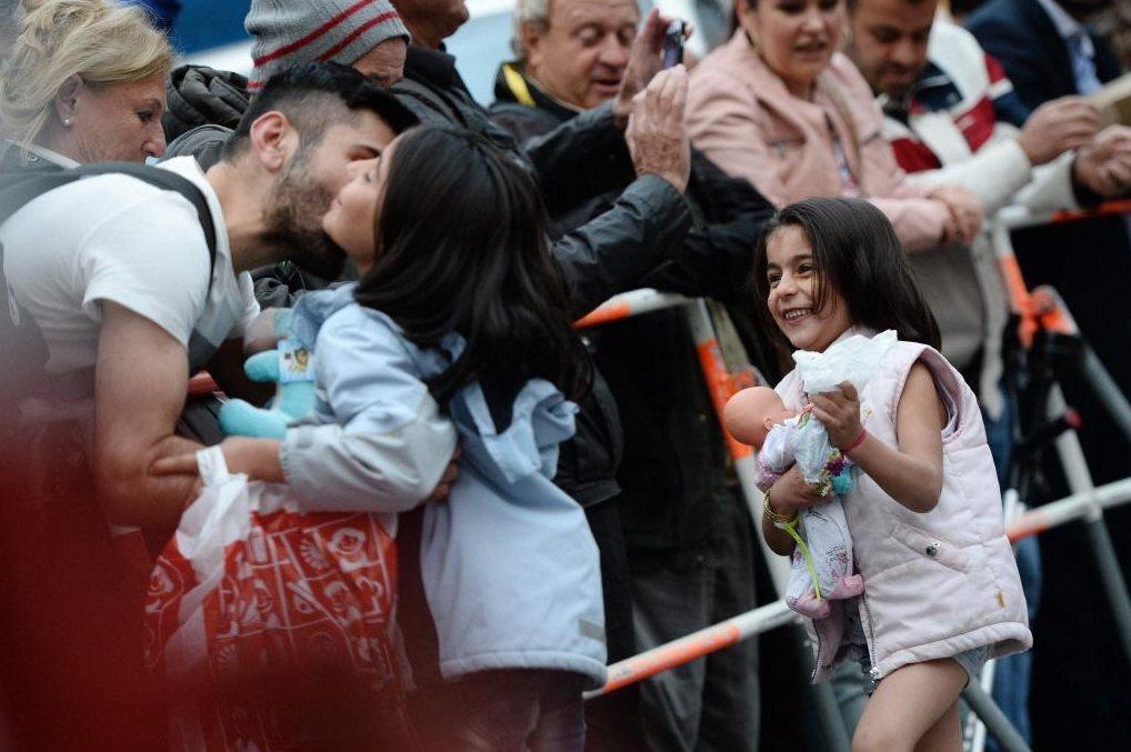 除了義工的照護,溫暖迎接首批難民的德國民眾,在當時鼓舞著大家的心。 圖/歐新社