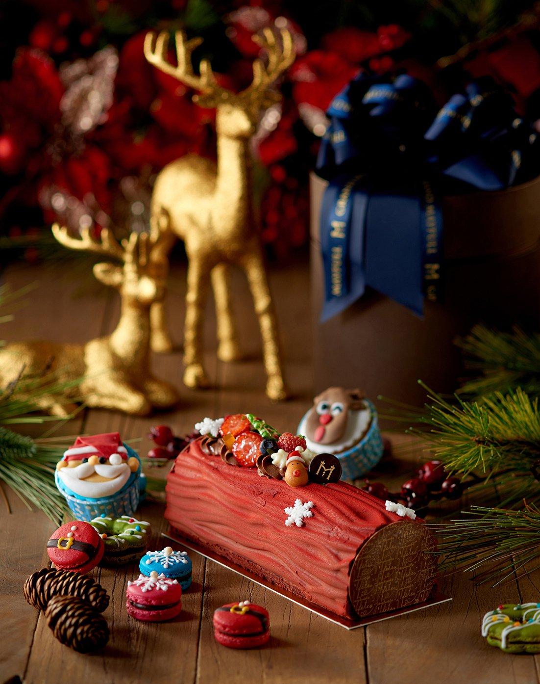 台北美福大飯店則選用巧克力沙布蕾搭配牛奶甘娜許及檸檬奶餡製成樹幹蛋糕。圖/台北美...