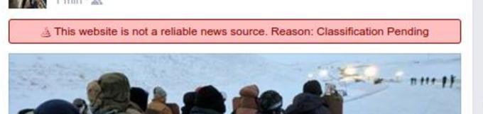 臉書在可能是假新聞的貼文上加上一條紅色的警告標語。圖擷自TechCrunch